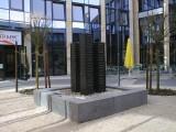 Brunnen Quartett, Basalt, 200 cm x 340 cm x 340 cm, Basaltblockeinfassung, integriertes Wasserbecken